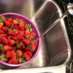 Add enough water to cover strawberries.