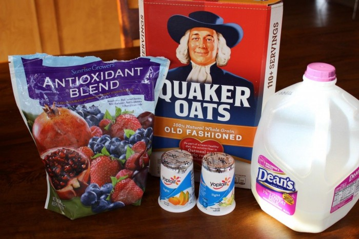 Ingredients including oatmeal, yogurt, milk and chopped fruit for no cook oatmeal.