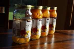 jars of canned peaches