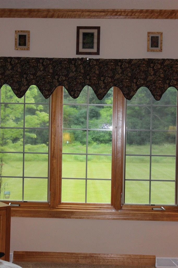 Old valances on family room window.