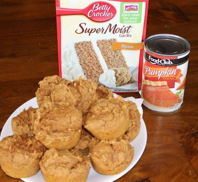 pumpkin muffins with a can of pumpkin and a box of spice cake mix in the background