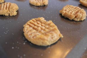 A baking sheet full of unbaked three ingredient peanut butter cookies