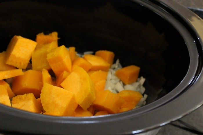 butternut squash cut into pieces in the crockpot