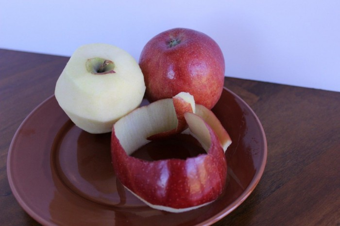 Peel two apples.