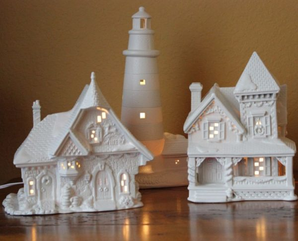 Old colorful porcelain Christmas houses that were spray painted white.