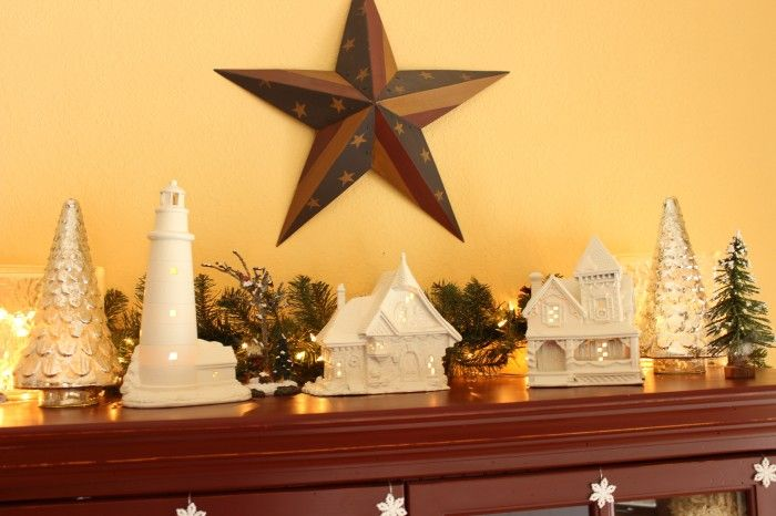 My white painted Christmas homes on top of my kitchen hutch.