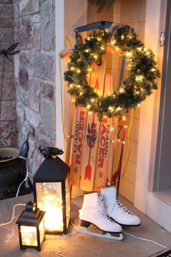 The sled with a wreath, lanterns and skates.