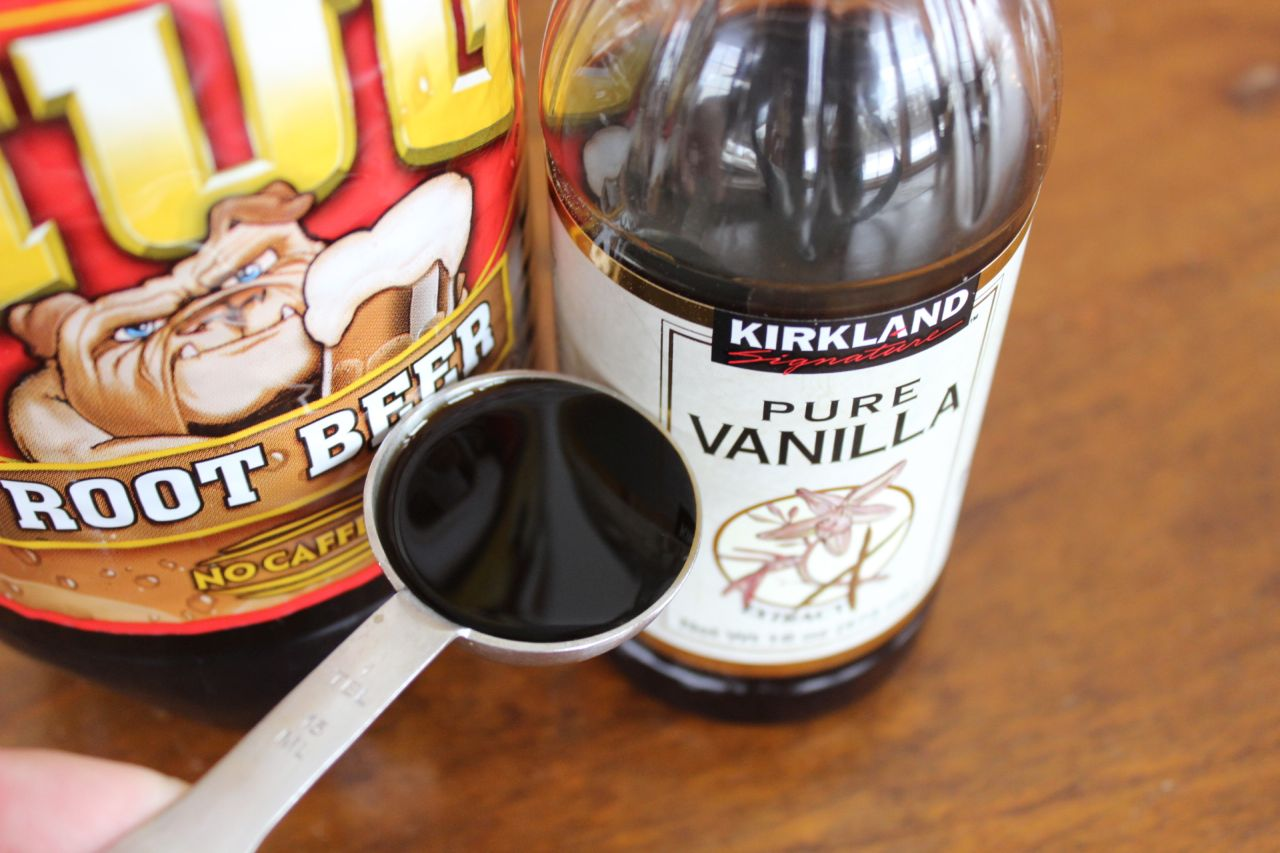 A bottle of root beer and a teaspoon of vanilla