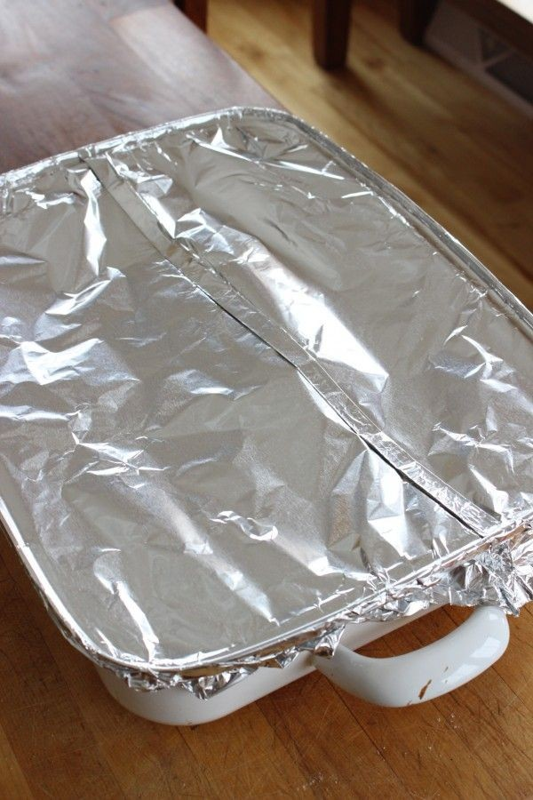 pan of ribs covered tightly with aluminim foil