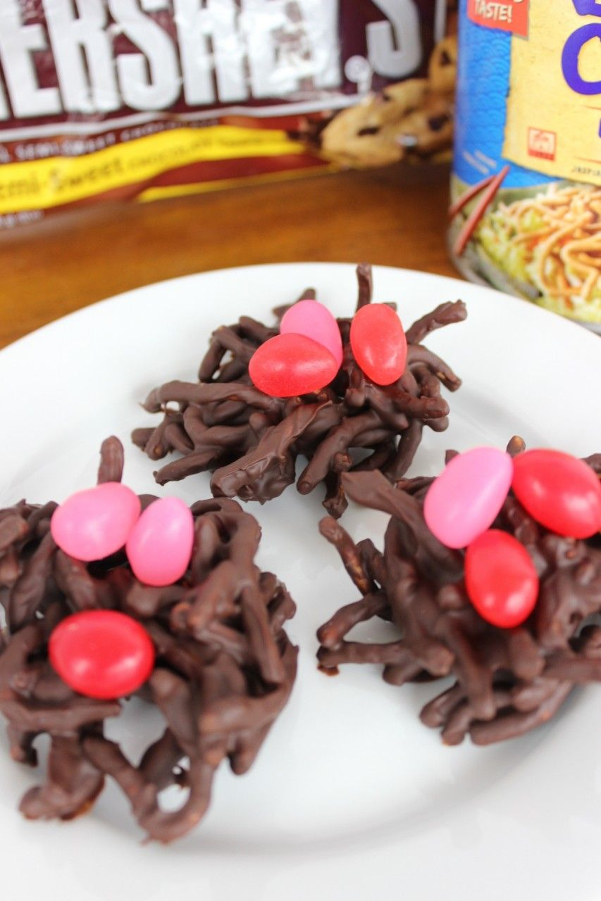 Chow mein cookies with red and pink jelly beans as eggs for Easter.