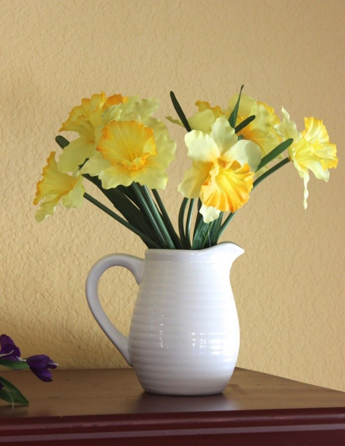 Spray painted white pitcher with daffodils