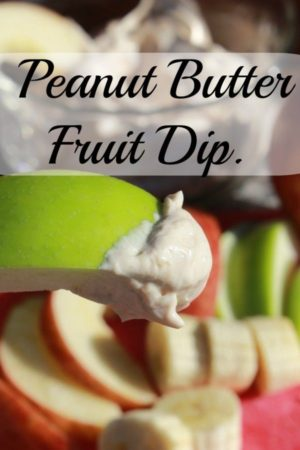 Peanut butter fruit dip on an apple slice.