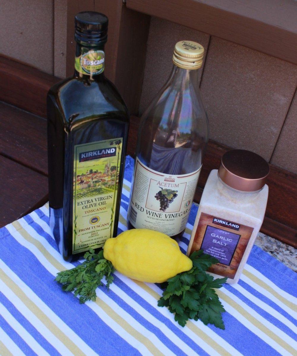Oil, red wine vinegar, garlic salt lemon and parsley as ingredients for the cowboy caviar marinade