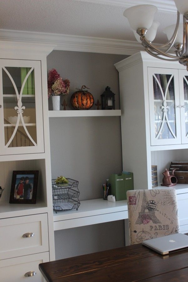 home office with white furnitue against gray walls