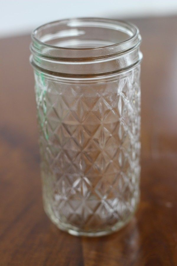 A mason jar with a nice pattern on it.