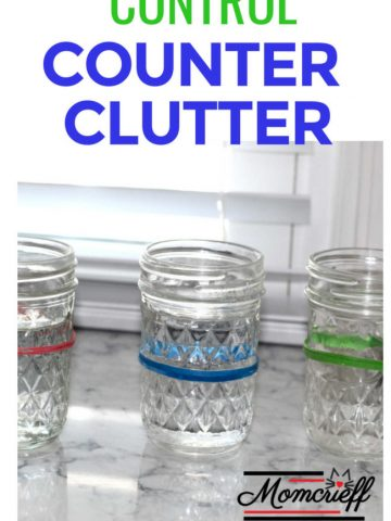 mason jars filled with water with different colored elastics around them.