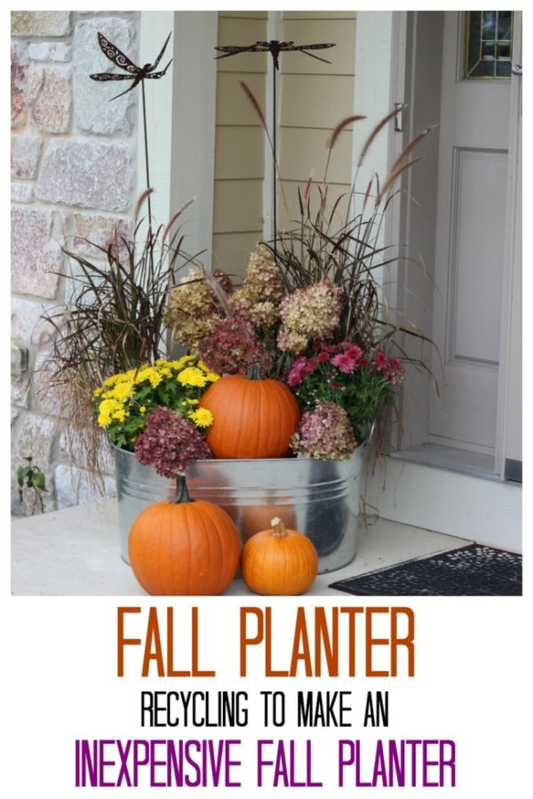 Fall planter with dried hydrangeas, my summer plater grasses, mums and pumpkins all in a big galvanized container.
