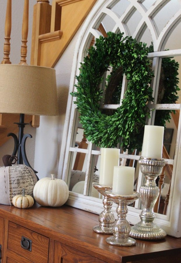 Neutral fall display using mercury glass candleholders with white candles, white pumpkins and my neutral fabric pumpkin.  All in front of my white chippy mirror with a boxwood wreath in the center!