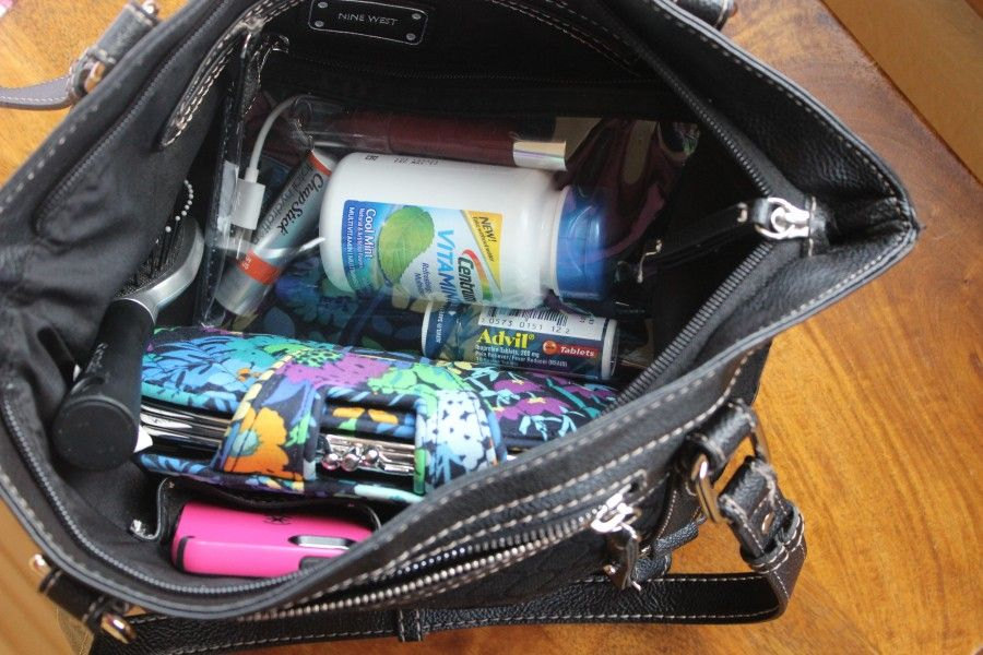 Organizing my purse with Pfizer purse essentials.