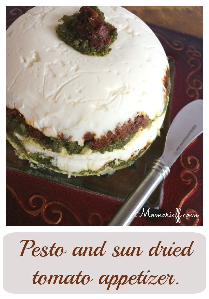 Pesto and sun dried tomato appetizer.  It looks amazing and can easily be prepared days ahead of time!  Love the red and green.