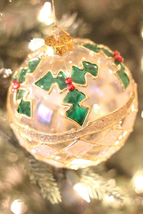 My favorite glass ornament with red and green holly on it.