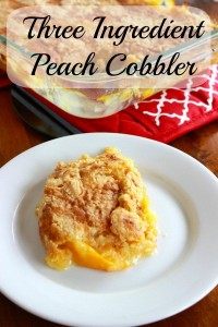 A plate of peach cobbler in front of a pan of hot cobbler.