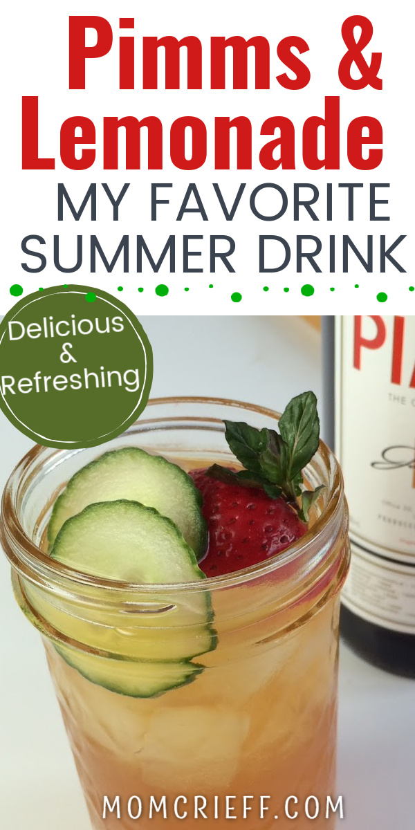 Pimms lemonade in a mason jar garnished with sliced cucumbers and strawberries