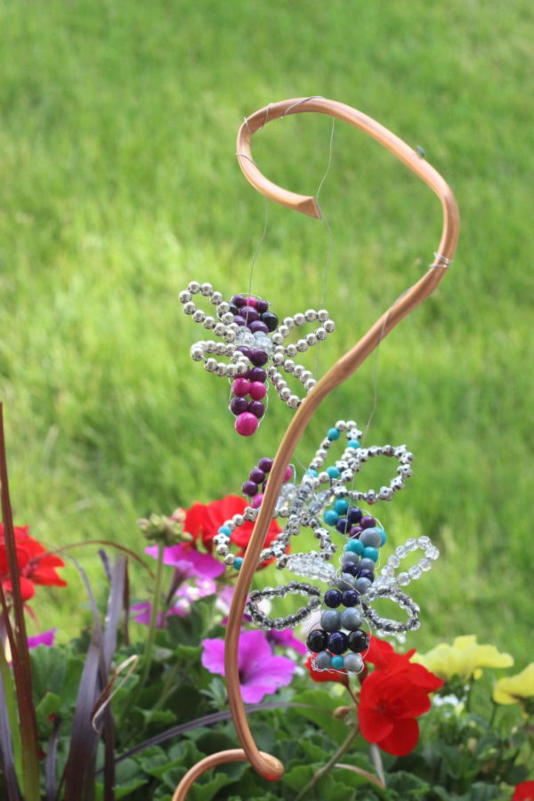 Beaded dragonflies hanging from shaped coper coil