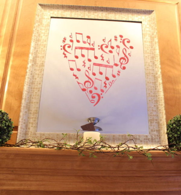 Valentines Stenciled Mirror with red painted music notes in a heart shape.
