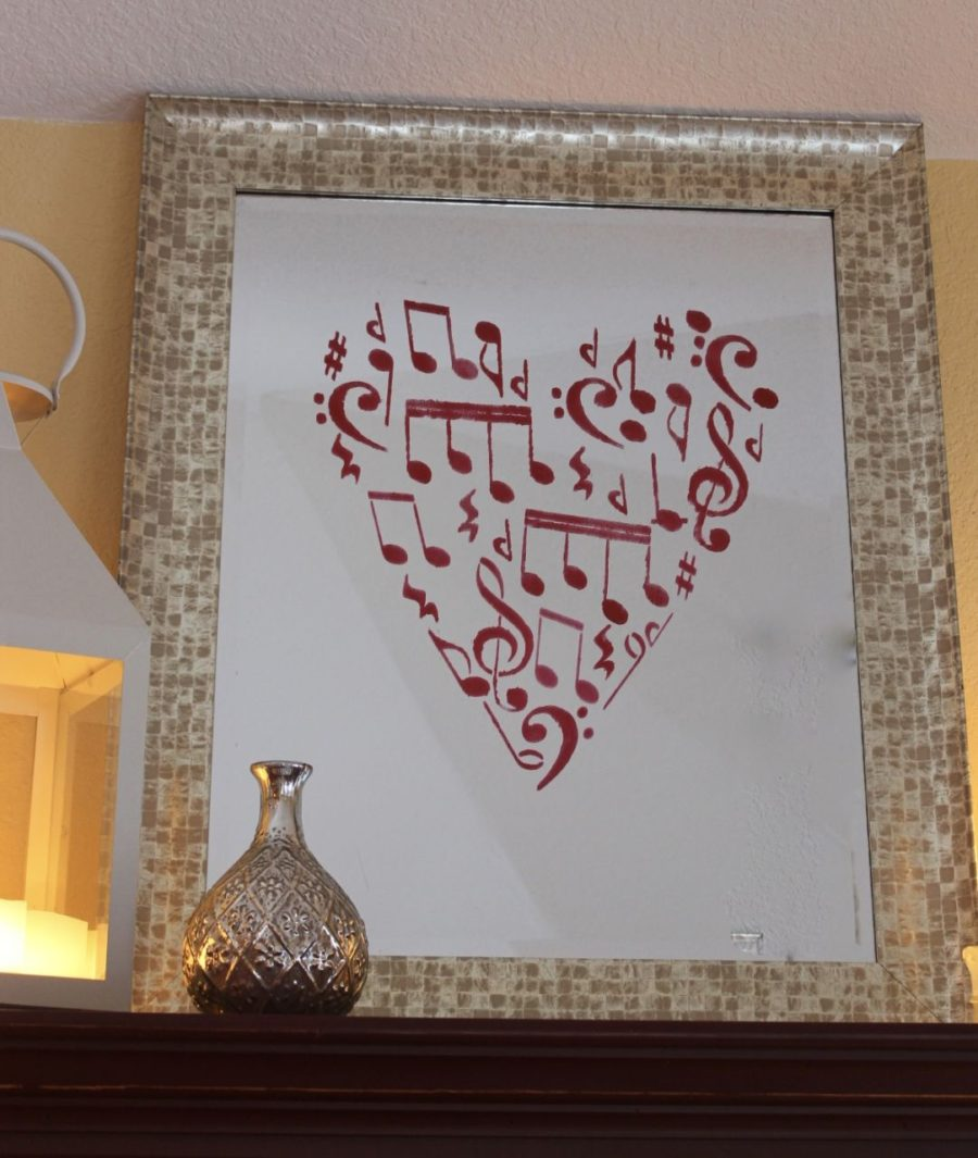 Mirror with red music notes in a heart shape