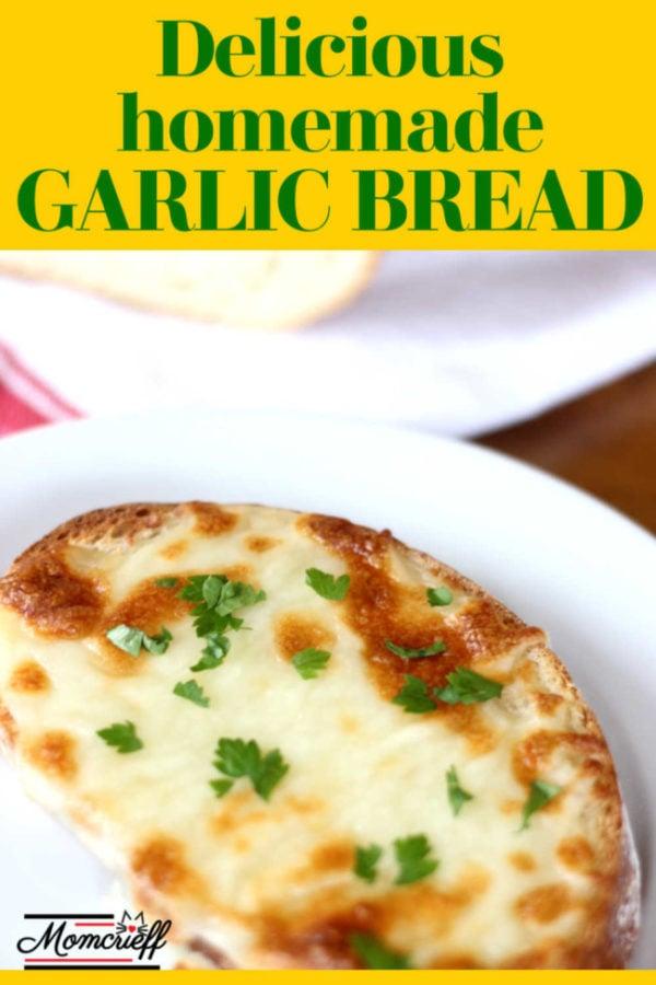 cheesy garlic bread on a white plate