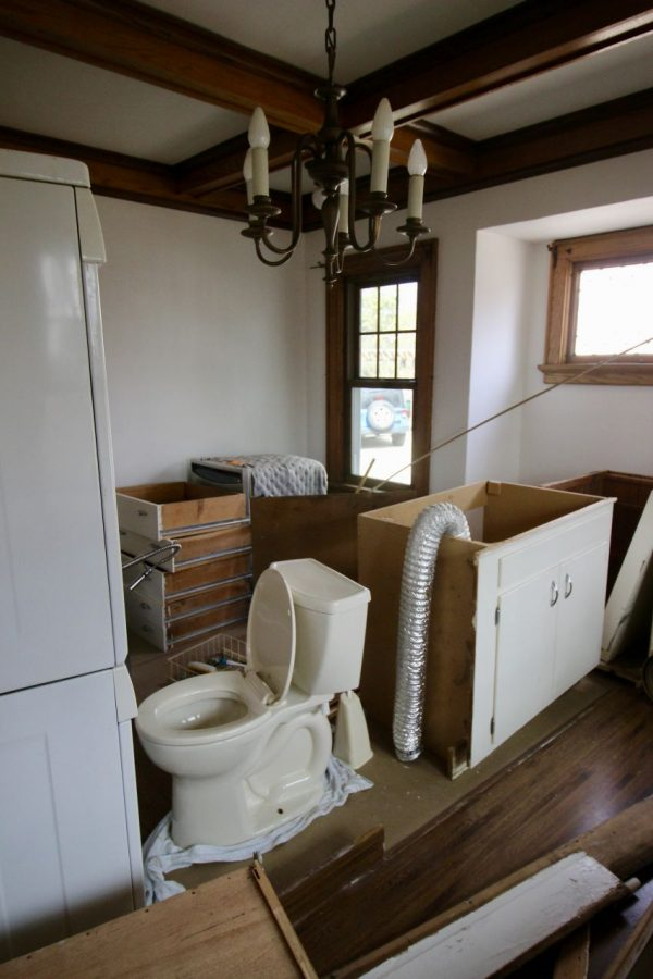 My fixer-upper had all the kitchen cabinets, the washer and dryer and the toilet in the dining room.