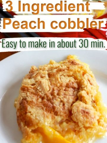 close up of some peach cobbler on a white plate