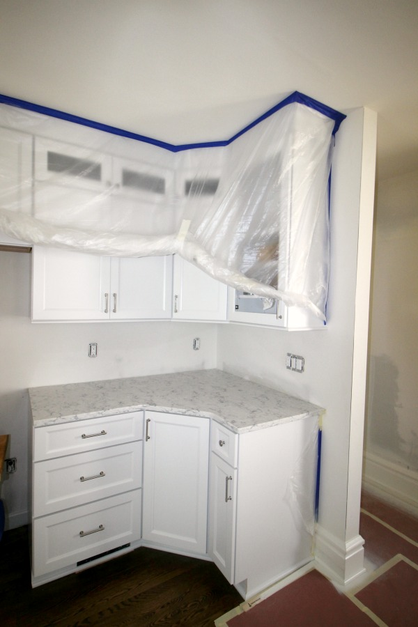 Plastic covering cupboards prior to painting.