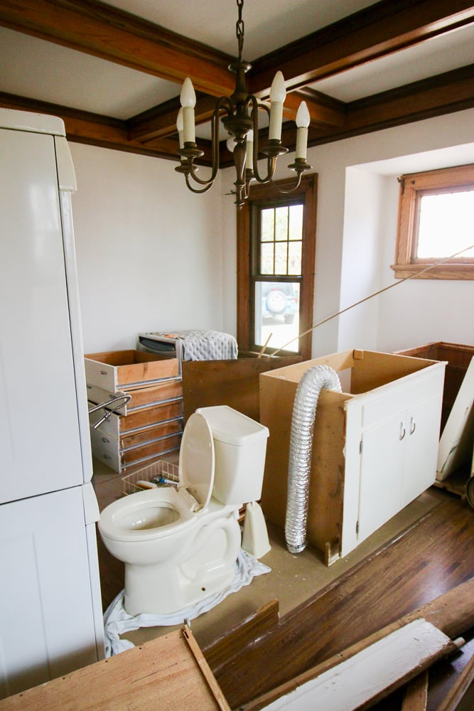 The dining room with the contents of the kitchen, powder room and laundry room.