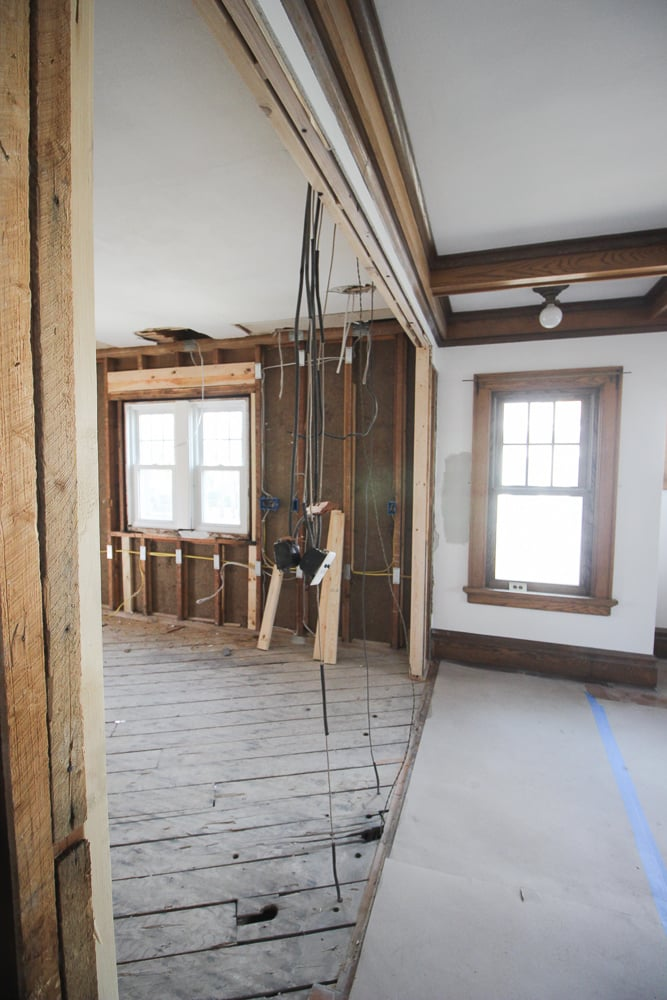 The wall between the kitchen and dining room was removed. All that was left was the dangling wires.