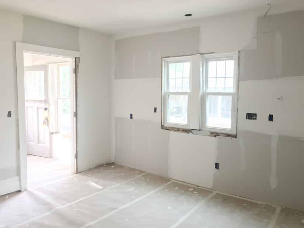 The walls in the kitchen are freshly drywalled.