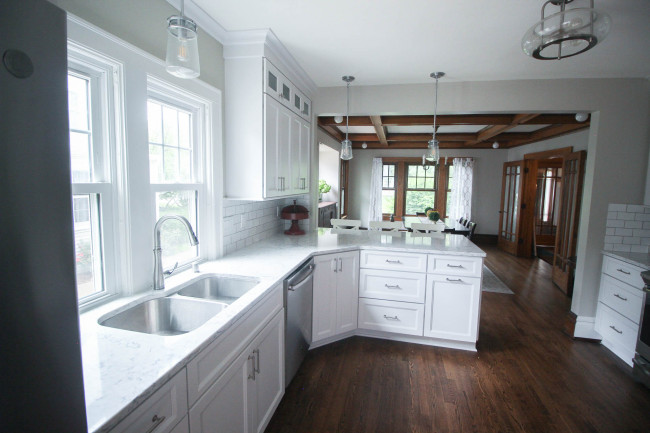 View of the white kitchen through to the original dining room.