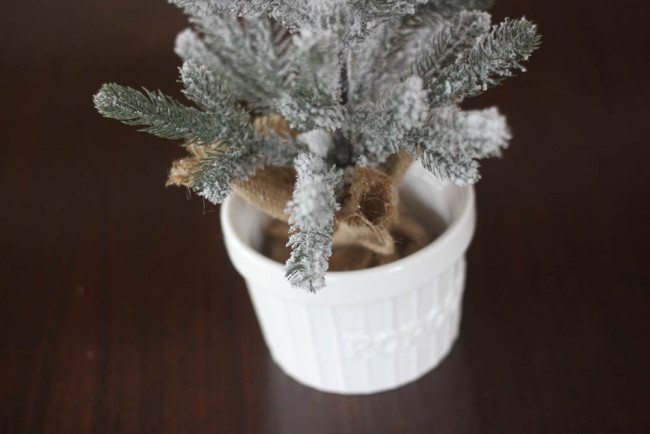 Small flocked tree placed into popcorn bowl.