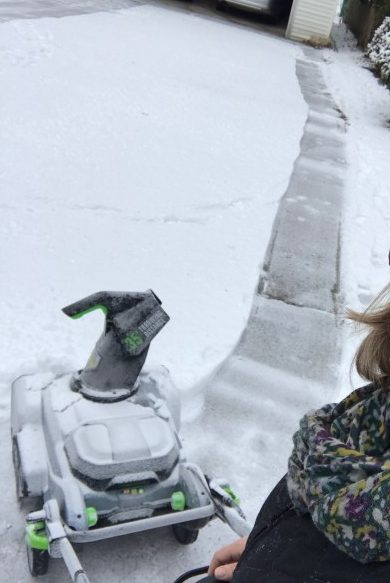 Using my battery operated snowblower.