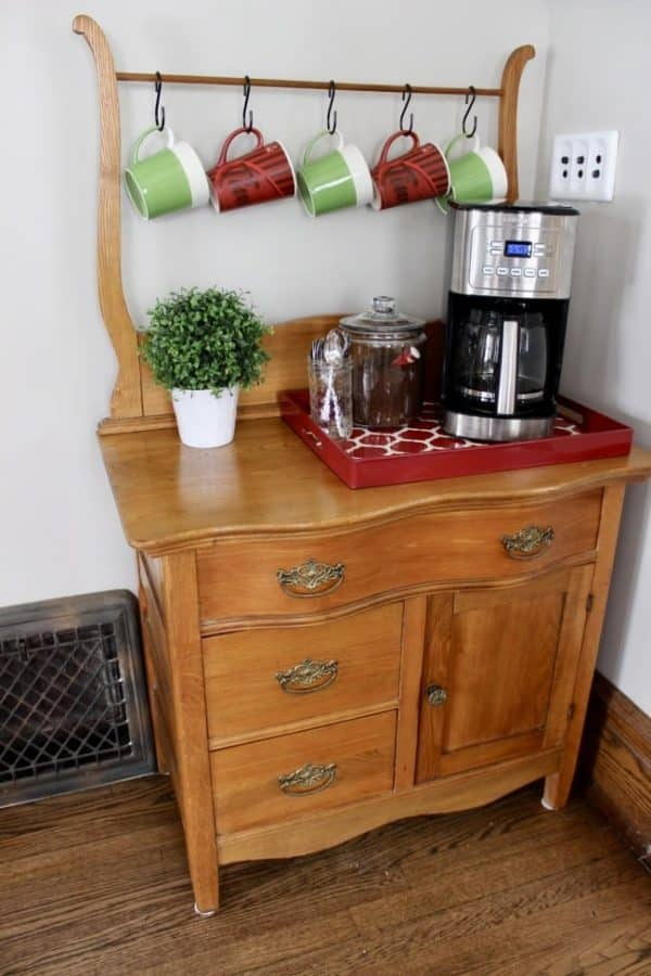 A coffee bar created from a vintage piece of bedroom furniture.