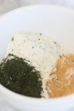 ranch dressing seasoning, dill weed and garlic seasoning in a bowl