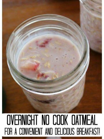 Mason jar containing oatmeal, yogurt and chopped strawberries.