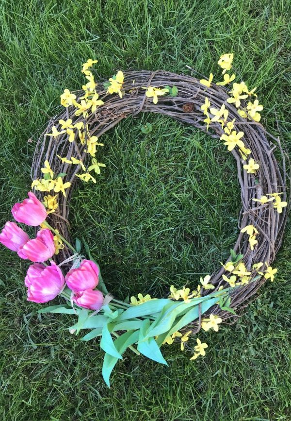 grapevine wreath with tulips and forsythia.