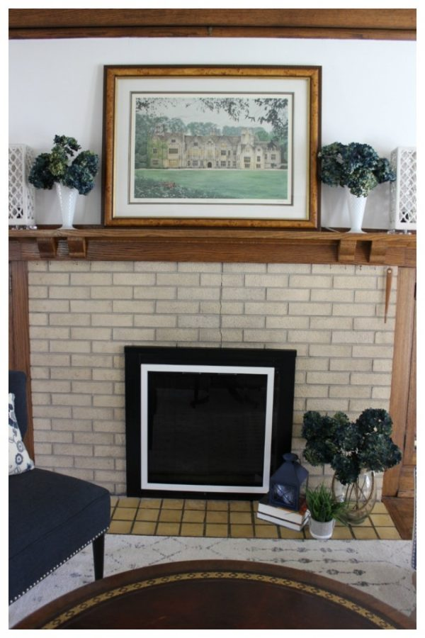 A view of the fireplace with the decorated mantle.