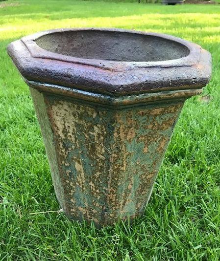 metal planter with rust and patina