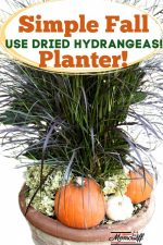 fall planter with tall grass, dried hydrangeas and orange pumpkins