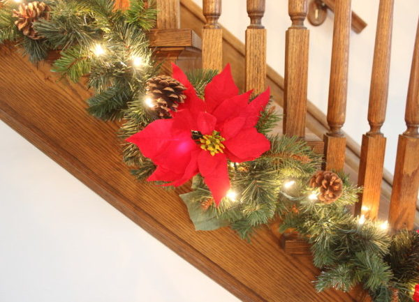 red pointsetta on my stairway Christmas garland