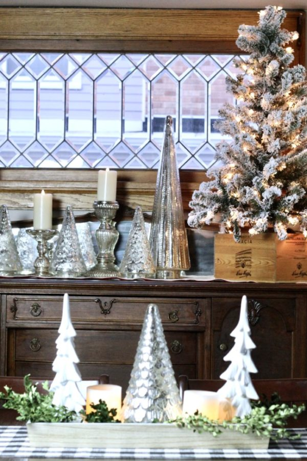 My Christmas dining room decorated with white candles, mercury glass and a small flocked tree.