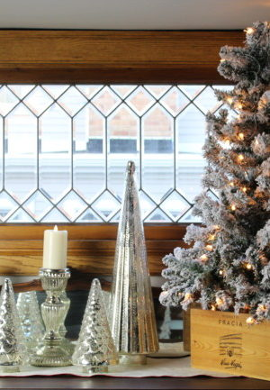 Small flocked Christmas tree with mercury glass trees in my dining room.